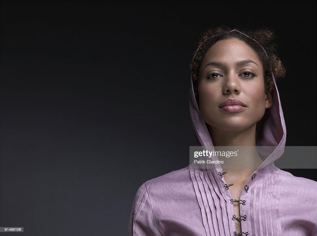 Mixed Race woman wearing hooded shirt : Stock Photo