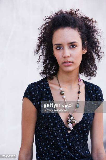 Mixed Race woman wearing necklace
