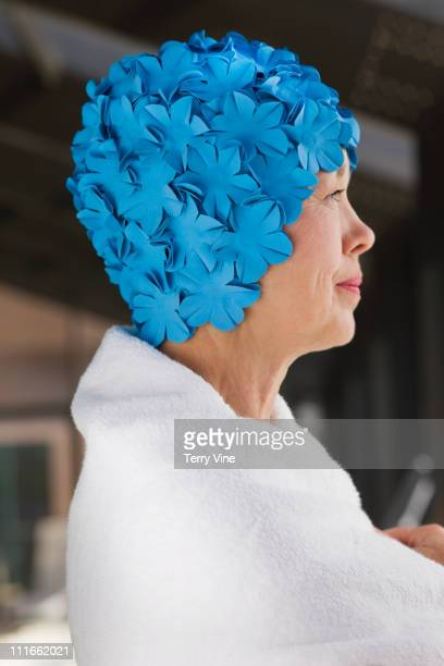 Mixed race woman wearing retro swimming cap wrapped in towel