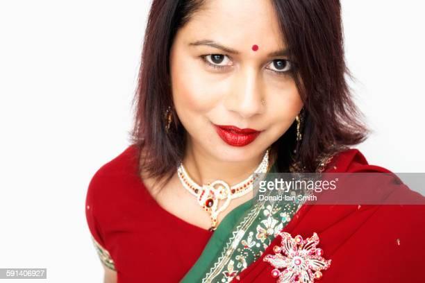 Mixed race woman wearing traditional sari