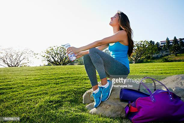 Mixed race woman wearing workout gear in park