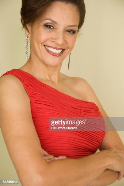 mixed race woman with arms crossed - evening gown stock pictures, royalty-free photos & images