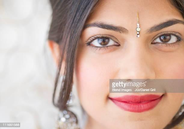 Mixed race woman with bindi on forehead