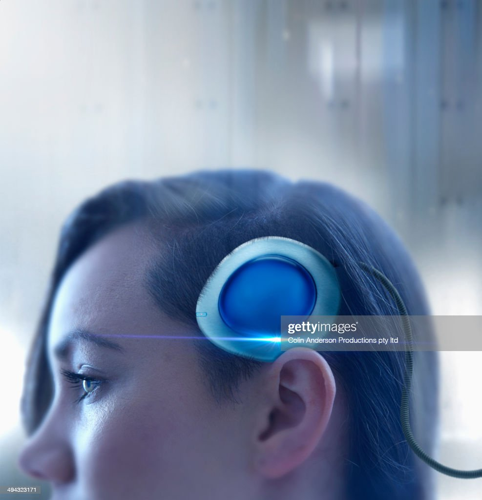 Mixed race woman with computer processor in head : Stock Photo