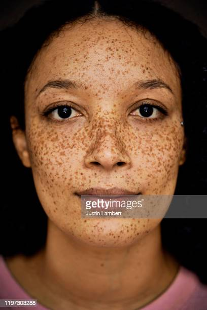 mixed race woman with freckles close up portrait - portrait stock pictures, royalty-free photos & images