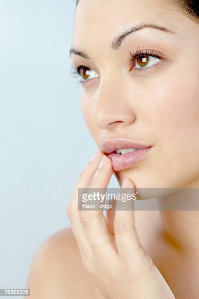 Mixed Race woman with hand on chin