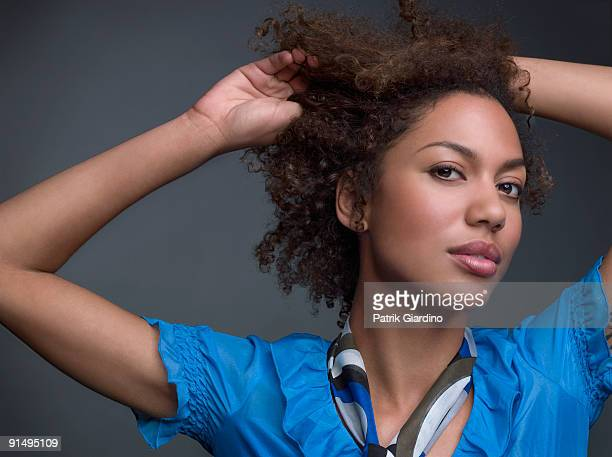 Mixed Race woman with hands in hair