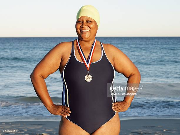 mixed race woman with medal on beach - images of fat black women stock photos and pictures
