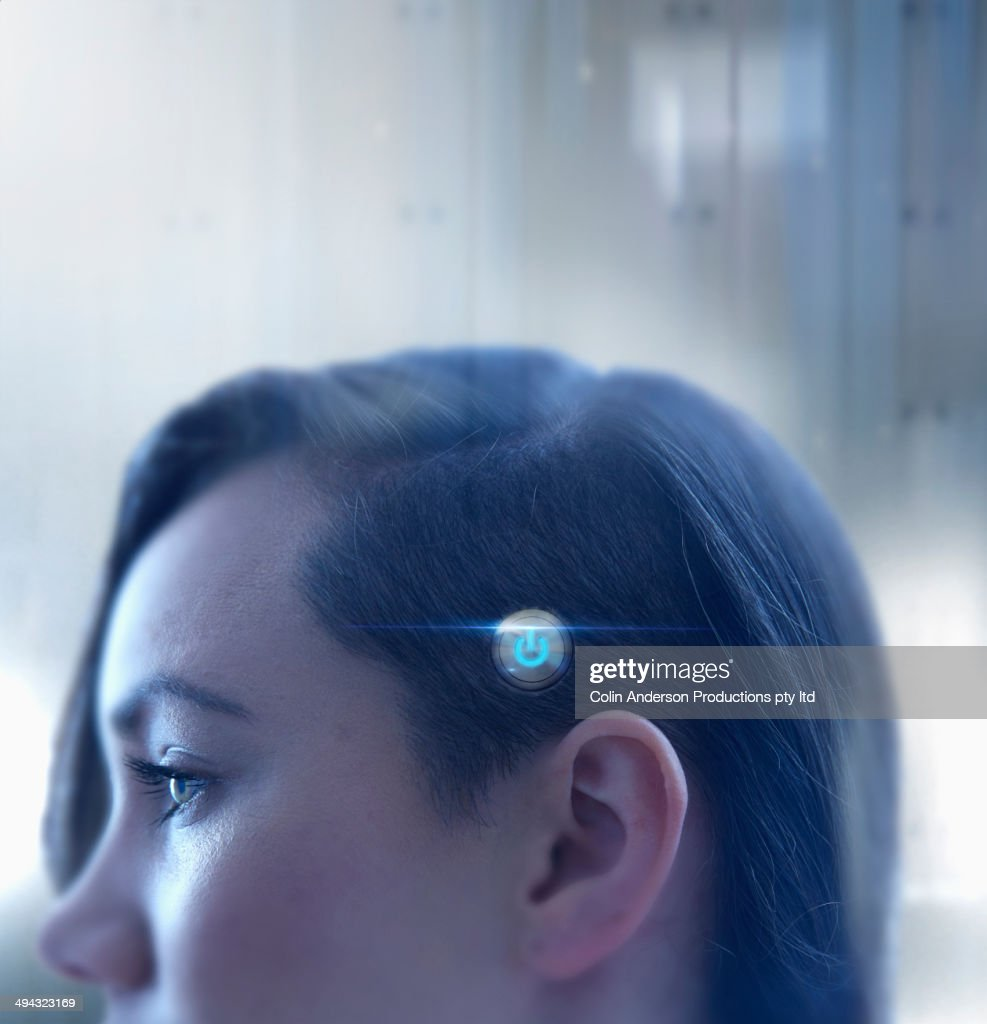 Mixed race woman with power button on head : Stock Photo