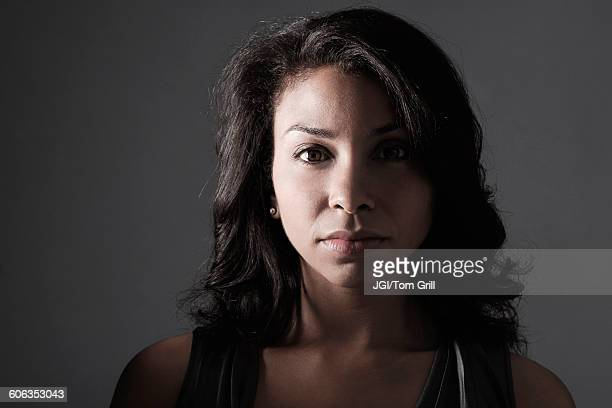 Mixed race woman with serious expression