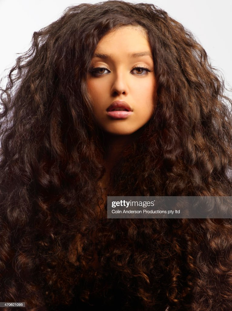 Mixed race woman with thick curly hair : Stock Photo