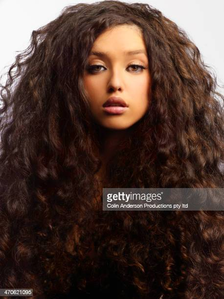 mixed race woman with thick curly hair - thick girls stock photos and pictures