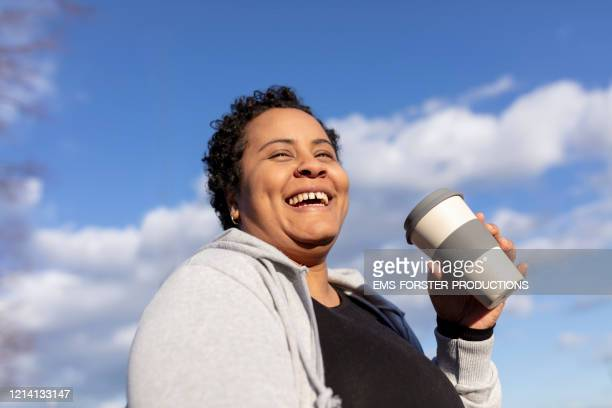 mixed race women with reusable cup with tea - plus size model stock pictures, royalty-free photos & images