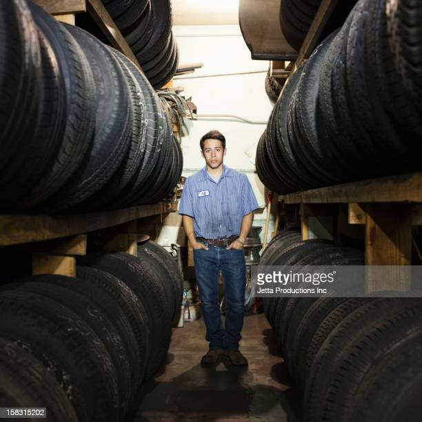 Mixed race worker in tire store