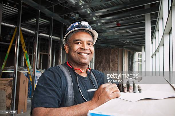 mixed race worker on construction site - foreman stock pictures, royalty-free photos & images