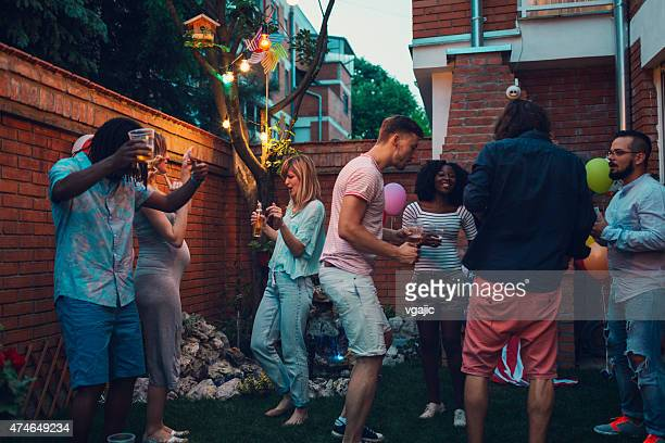 Mixed Race Young Happy People Dancing At Backyard Party.