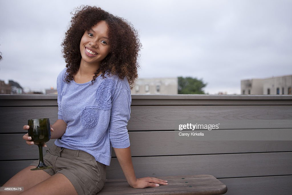Mixed race young woman at a roof party : Stock Photo