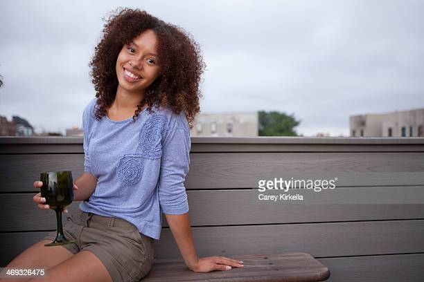 Mixed race young woman at a roof party