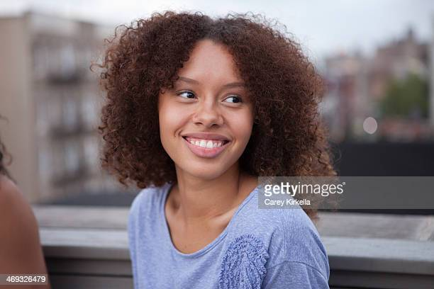 mixed race young woman at a roof party - 16 17 jahre stock pictures, royalty-free photos & images