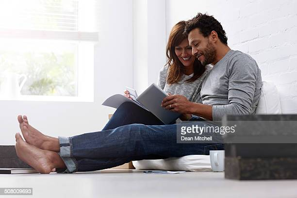 Mixed raced couple calculating their expenses