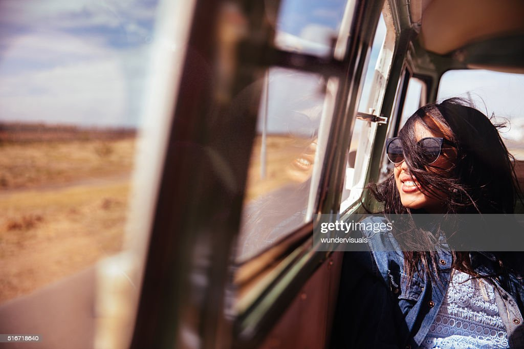Mixed Raced Hipster Woman Smiling in Retro Van Road trip : Stock Photo