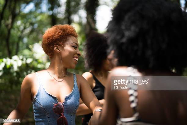 mixed racial group dancing - nigerian girls stock photos and pictures