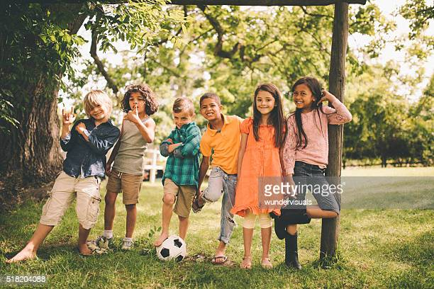 Mixed racial group of boys and girls with soccer ball