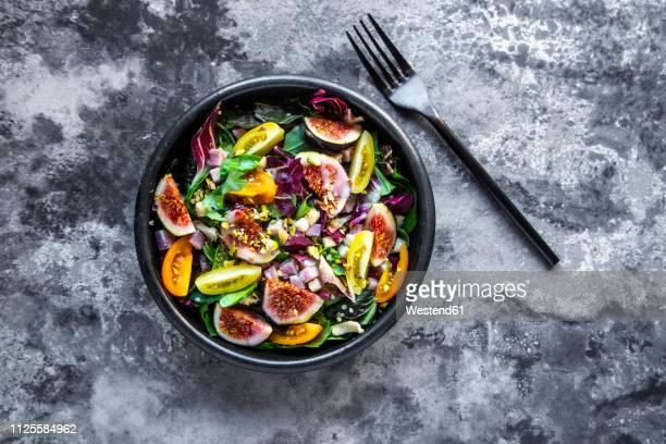 mixed salad with fig, tomato, ham, cheese, pistachio - salad stock-fotos und bilder