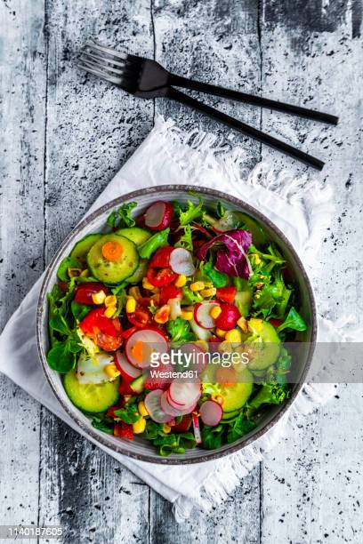 mixed salad with red radish, cucumber, bell pepper, tomato, maize and carrot - salad bowl stock pictures, royalty-free photos & images