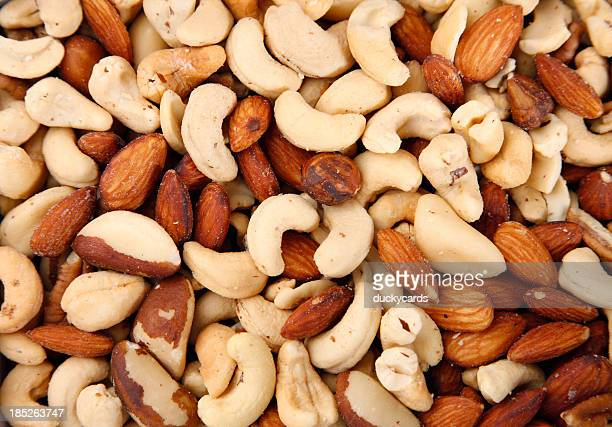 mixed salted nuts - salted stock pictures, royalty-free photos & images