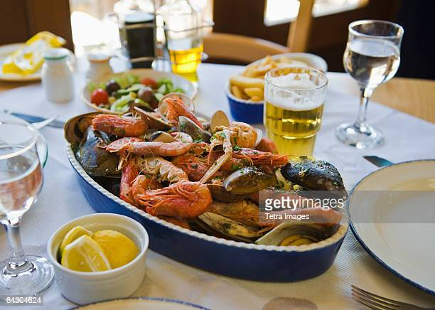 mixed seafood on restaurant table - maltese islands stock photos and pictures