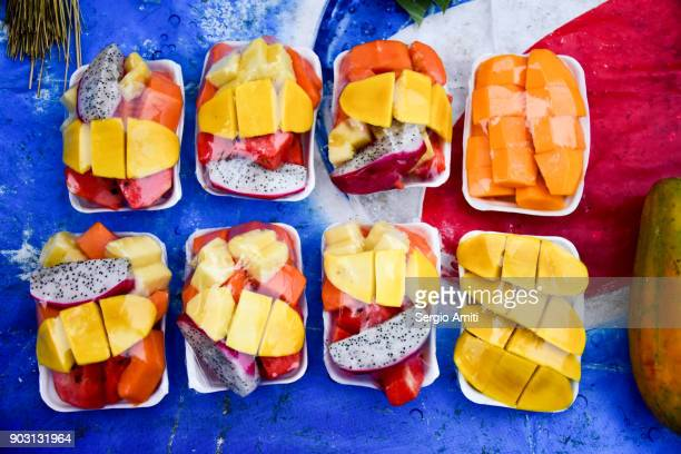 Mixed sliced tropical fruits on sale in Laos