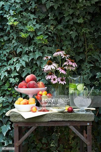mixed stone fruit on a garden table