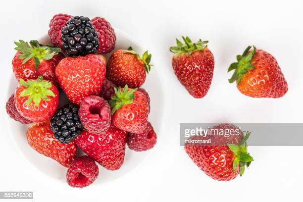 mixed summer berries fruits. strawberries, blackberries and raspberries - fraise photos et images de collection