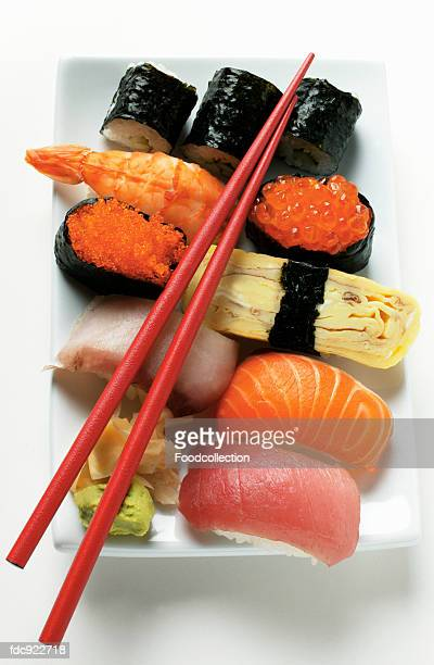 mixed sushi platter with red chopsticks - pickled ginger stock pictures, royalty-free photos & images