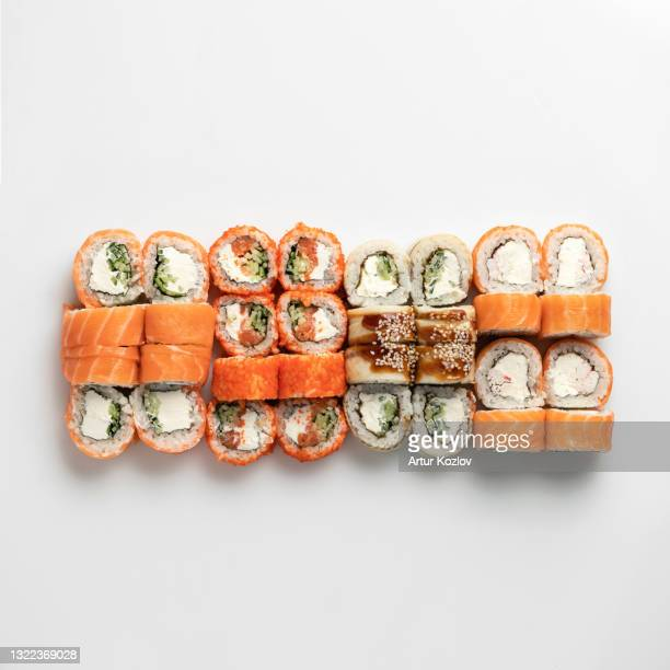 mixed sushi set isolated on white background. inside out rolls. traditional japanese food. healthy oriental meal. wellness concept. flat lay. top view. copy space - prato de soja - fotografias e filmes do acervo
