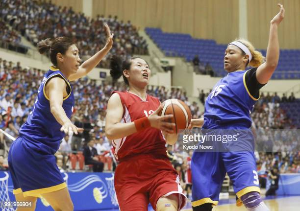 Mixed teams of North and South Korean basketball players take part in friendly matches in Pyongyang on July 5 2018 The event was proposed by North...