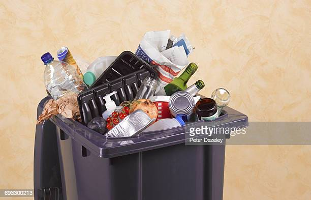 mixed waste in rubbish bin - food contamination stock photos and pictures