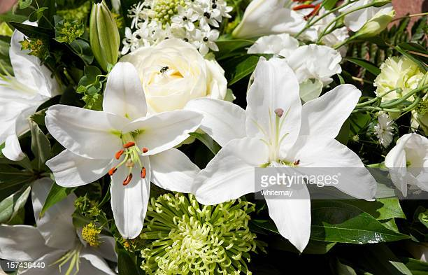 Mixed white funeral flowers
