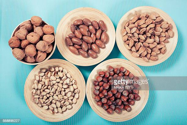 Mixed whole nuts in bamboo bowl