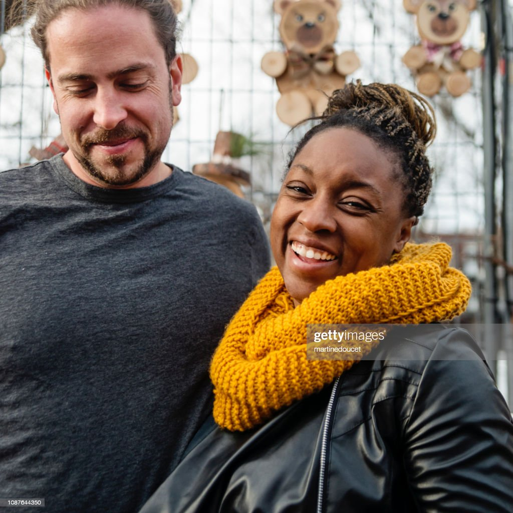Mixed-race couple on city street in winter. : Stock Photo