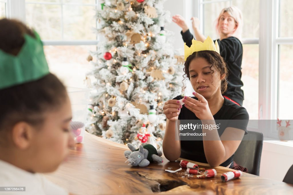 Mixed-race family decorating the Christmas tree. : Stock Photo