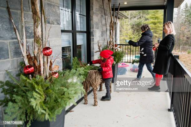 """mixed-race family making diy seasonal decorations on balcony outdoors. - """"martine doucet"""" or martinedoucet stock pictures, royalty-free photos & images"""
