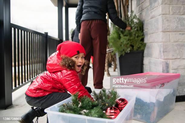"mixed-race family making diy seasonal decorations on balcony outdoors. - ""martine doucet"" or martinedoucet imagens e fotografias de stock"
