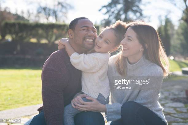 mixed-race family portrait - mixed race person stock pictures, royalty-free photos & images