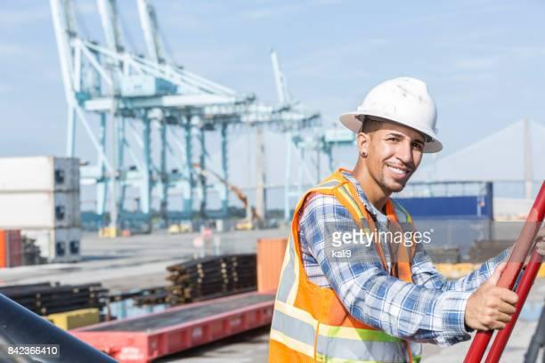 Mixed-race Hispanic man working at shipping port