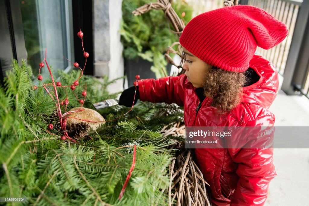 Mixed-race little girl painting diy seasonal outdoors decorations. : Stock Photo