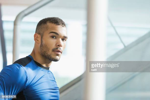 mixed-race man in workout clothing, bottom of stairs - handsome native american men stock pictures, royalty-free photos & images