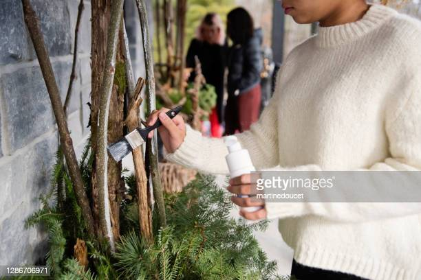 """mixed-race teenage girl painting diy seasonal outdoors decorations. - """"martine doucet"""" or martinedoucet stock pictures, royalty-free photos & images"""