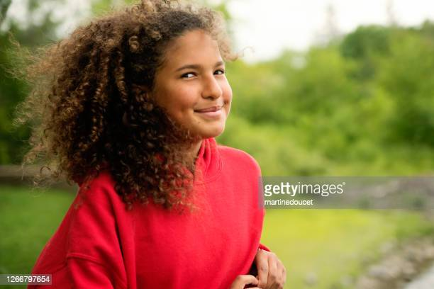 """mixed-race teenage girl portrait on riverside. - """"martine doucet"""" or martinedoucet stock pictures, royalty-free photos & images"""